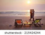 happy couple on the beach at... | Shutterstock . vector #215424244