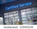 Auto Service. Certified Car Service Gates at Night. - stock photo