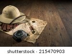Small photo of Old treasure map with colonial style pith hat, bras telescope and compass.