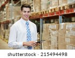 smiling manager in warehouse...   Shutterstock . vector #215494498