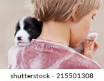 Stock photo little girl with the puppy border collie 215501308