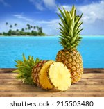 Pineapple On Wooden Table In A...