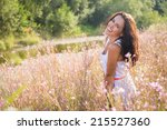 young brunette woman in a white ... | Shutterstock . vector #215527360