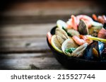mix of mussels clams and... | Shutterstock . vector #215527744