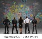 business team drawing a new... | Shutterstock . vector #215549044