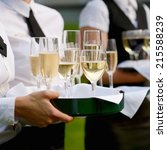 waitress with dish of champagne ... | Shutterstock . vector #215588239