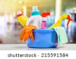 basket with cleaning items on... | Shutterstock . vector #215591584