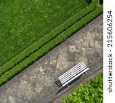 Small photo of Geometric background with a white bench in a green park. Top view