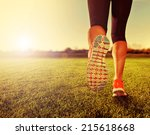 an athletic pair of legs on... | Shutterstock . vector #215618668