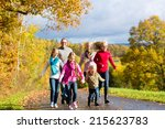 girls running ahead at family... | Shutterstock . vector #215623783