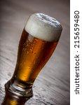 pint of honey brown beer | Shutterstock . vector #215659480