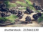 Pine Cones On Wooden Backgroun...