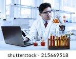 asian chemist working in... | Shutterstock . vector #215669518
