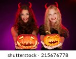 two carved halloween pumpkins... | Shutterstock . vector #215676778