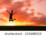happy woman jumping against...