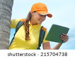 side view of young woman in cap ... | Shutterstock . vector #215704738