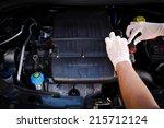 Small photo of mechanic checks auto electronic control unit, ecu