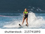 Young Woman Water Skiing On A...