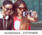 young fashion couple taking... | Shutterstock . vector #215743600