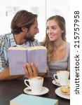 happy couple enjoying a coffee... | Shutterstock . vector #215757958