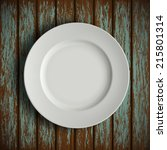 white plate on old wooden table | Shutterstock .eps vector #215801314