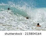 children playing in sea waves... | Shutterstock . vector #215804164