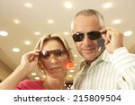 mature couple trying on... | Shutterstock . vector #215809504