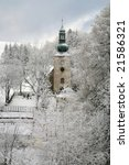 Old church in Pasterka by winter. Poland - stock photo