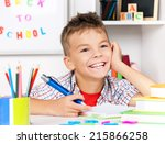 young boy sitting at desk in... | Shutterstock . vector #215866258