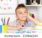 young boy sitting at desk in... | Shutterstock . vector #215866264