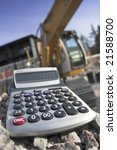 pocket calculator and construction. - stock photo