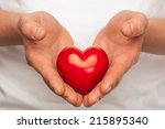 man with red heart in his hands ...   Shutterstock . vector #215895340