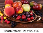 Different Berries And Fruits O...