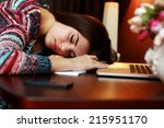 tired woman sleeping on the... | Shutterstock . vector #215951170