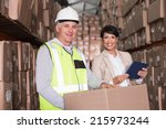 warehouse worker moving boxes... | Shutterstock . vector #215973244