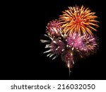 Fireworks light up the sky with ...