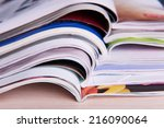magazines on wooden table close ... | Shutterstock . vector #216090064