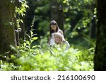 mother and daughter reading... | Shutterstock . vector #216100690