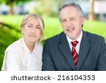 business partners smiling in an ... | Shutterstock . vector #216104353