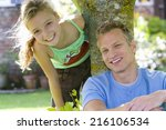 father and daughter by tree ... | Shutterstock . vector #216106534