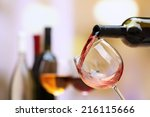 red wine pouring into wine... | Shutterstock . vector #216115666