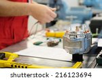 hands of mechanic restores a... | Shutterstock . vector #216123694