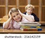 girl sitting at school desk ... | Shutterstock . vector #216142159