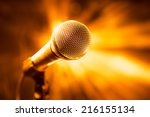 golden microphone on stage | Shutterstock . vector #216155134