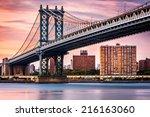 Manhattan Bridge Under A Purpl...