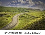 Curved shape asphalt road in high mountains of Iceland - stock photo