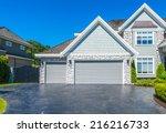 triple doors garage with nicely ... | Shutterstock . vector #216216733