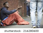 Homeless Teenage Boy Begging...