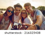group of young friends near... | Shutterstock . vector #216325438