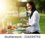 mother serving food at cookout... | Shutterstock . vector #216334753
